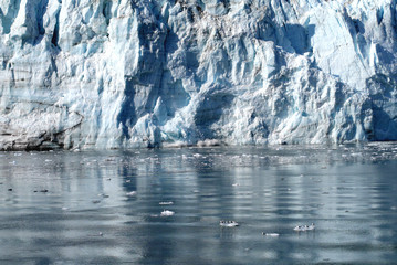 Packed blue ice of glacier shinning in the sun , Glacier Bay, Alaska