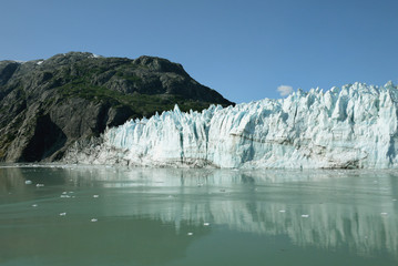 tidewater glacier glistening in the sunlight in Glacier Bay national Park Alaska