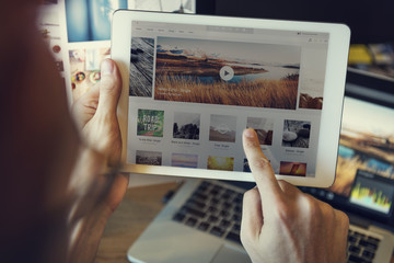 Using Tablet Searching Browsing Travel Website Concept