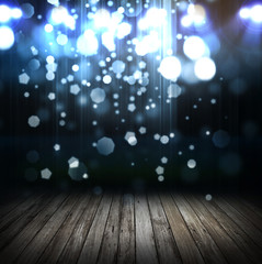 spot lighting over dark background and wood floor