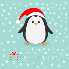 Kawaii Penguin wearing Santa red hat. Cute cartoon character. Flat design Winter antarctica bluebackground with snow. Merry Christmas Candy cane text. Greeting card.