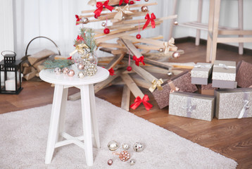 Table with Christmas decoration in living room