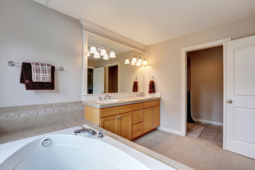 Bright and clean bathroom interior with double sink vanity cabinet.