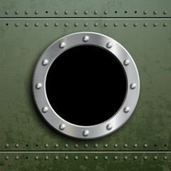 Round window porthole on green metal background. Military armor