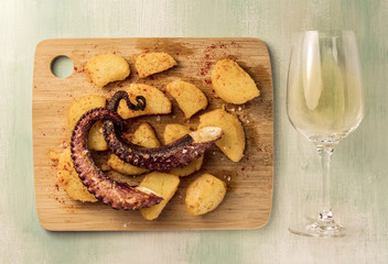 Octopus with potatoes and white wine, traditional Spanish meal