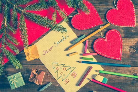 Letter to Santa Claus with Christmas tree and gift boxes