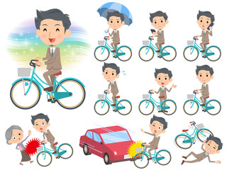 Beige suit short hair beard man ride on city bicycle