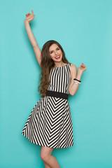 Carefree Elegant Woman In Striped Dress
