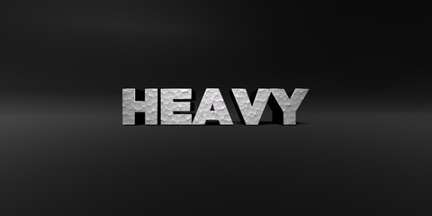 HEAVY - hammered metal finish text on black studio - 3D rendered royalty free stock photo. This image can be used for an online website banner ad or a print postcard.