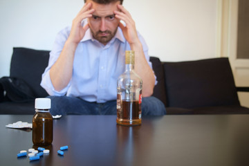 Depressed man taking some pills