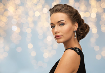 woman in evening dress and earring