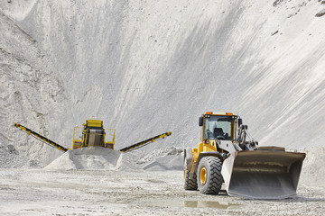 Quarry aggregate with heavy duty machinery. Construction industr Wall mural