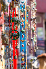 Deurstickers Historisch mon. Garlands home decorations for sale on local Pushkar market, India.