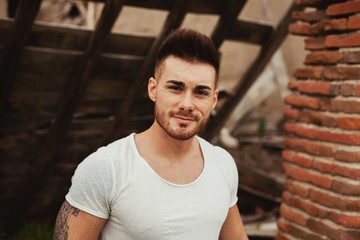 Attractive guy with white t-shirt in a old house