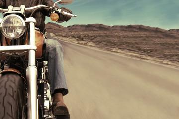 Biker On the road over blue sky