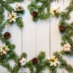 Christmas wooden background with fir tree and decoration