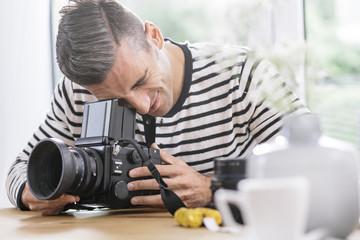 Man at home checking camera