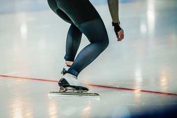 feet athlete speed skater at start sprint race on ice rink. competitions in speed skating
