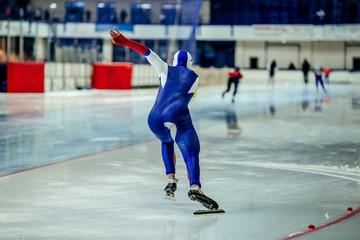 explosive start man athlete speed skater. race in speed skating