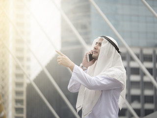 Portrait of young Arab man in the city