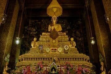 Golden buddha in hall, Wat Phra Chetupon Vimolmangklararm (Wat Pho) temple, Thailand. Photo taken on: 2 November , 2016