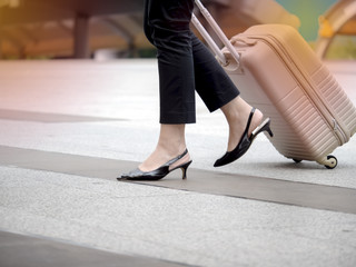 Business woman departure with luggage at transit station
