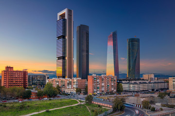 Wall Murals Madrid Madrid. Image of Madrid, Spain financial district with modern skyscrapers during sunset.