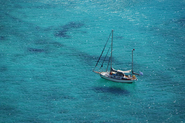 yacht sailing the turquoise sea waters - view from above