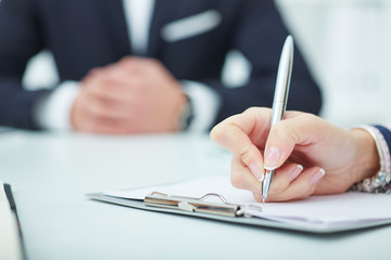 Close up of business people hands during teamwork. Business woman making notes at office workplace. Business job offer, financial success, certified public accountant concept.
