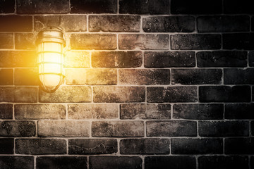 night dark grunge wall with light lamp.