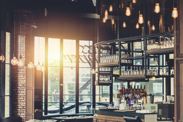modern loft style restaurant decoration with hanging light bulb beer pub and bar. Wall mural