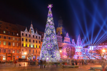 Christmas tree and light laser show on Market Square at christmas night in Wroclaw, Poland