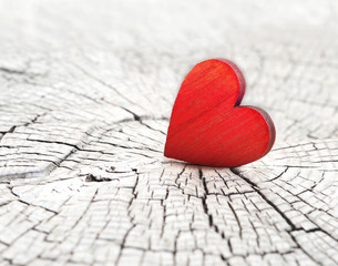 red heart on a cracked wooden background