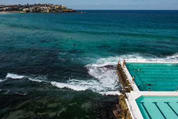 People swimming at the famous Bondi Beach Icebergs swimming pool in Bondi, Sydney, Australia