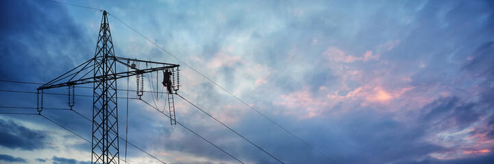Maintenance Work on Top of an Electric Power Pole