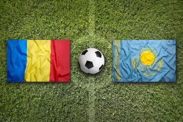Romania vs. Kazakhstan flags on soccer field