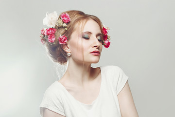 beautiful blonde with flowers in her hair. beauty