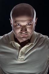 brutal portrait of a bald man bristles