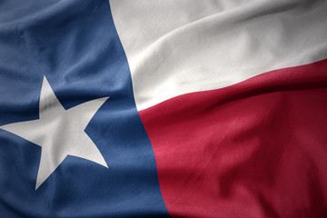 Photo sur Aluminium Amérique du Sud waving colorful flag of texas state.