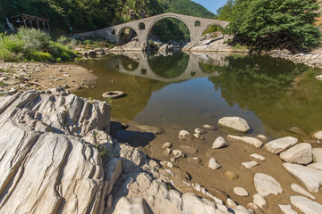 Reflection of The Devil's Bridge in Arda river and Rhodopes mountain, Kardzhali Region, Bulgaria