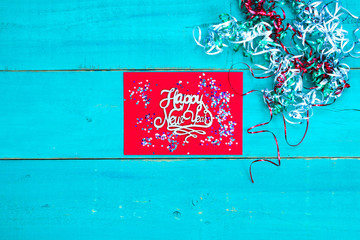 Colorful Happy New Year sign with ribbon and confetti