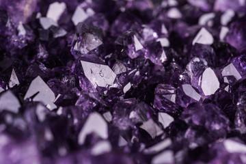 Amethyst geode on black background. Beautiful natural crystals gemstone. Extreme close up macro shot.