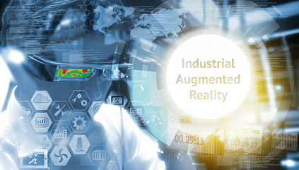 Industry 4.0, Augmented reality , iot and smart logistic concept. Man using AR glasses for check maintenance of machine in smart factory. Infographic and texts of industrial (IAR).