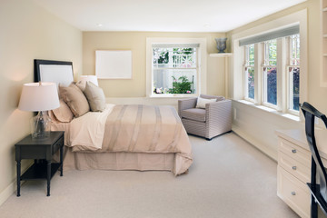 decorated beige Bedroom.