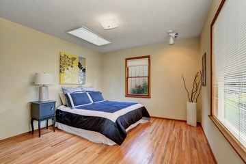 Simply furnished bedroom interior with hardwood floor