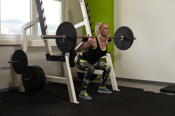 Healthy Woman Doing Exercise For Legs