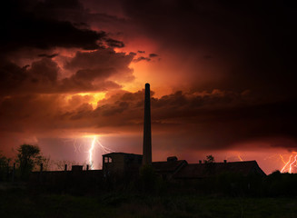 Thunder, lightnings and storm over abandoned factory in summer