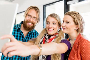 Young Friends Taking Selfie In office