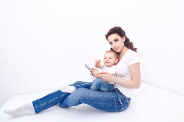 Fototapeta Mother and daughter. Tablet PCs