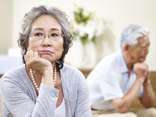 senior asian couple having marital problems